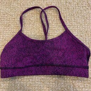 Purple and black speckled lululemon sports bra